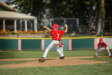 Fototapety Young pitcher on the mound in a youth baseball game