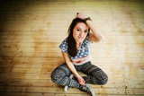Street dancer girl wearing casual clothes on footless sitting ba