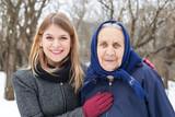 Elderly woman with her caretaker - 134567575