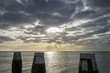 Afsluitdijk with Jetty Poles and Sunrise