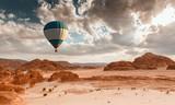 Hot Air Balloon travel over desert - 134588545