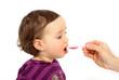 Leinwanddruck Bild - Kleinkind schluckt Medizin