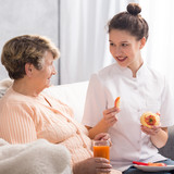 Caregiver giving healthy meal