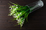 Bouquet artificial lily of the valley in a glass