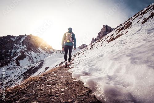 Man running on the snow on a mountain - 134666380