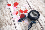Heart punch and paper hearts,making Valentine's day decoration - 134695560