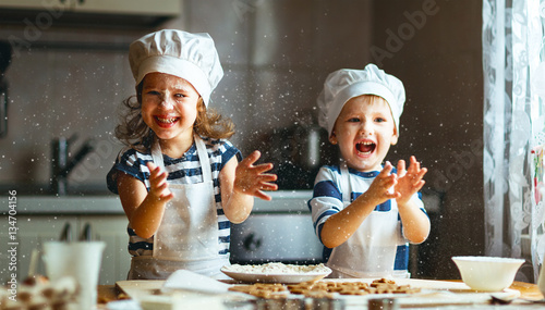 Leinwanddruck Bild happy family funny kids bake cookies in kitchen