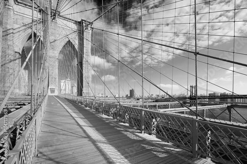 Empty Brooklyn Bridge footpath in a sunny day, New York in black and white