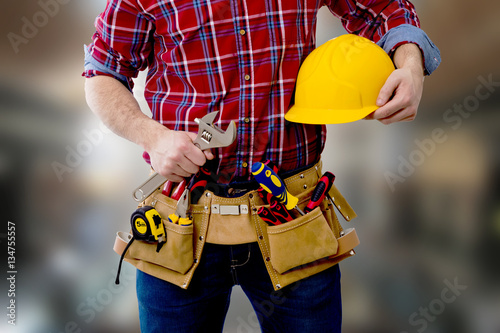 constructor with helmet and tools