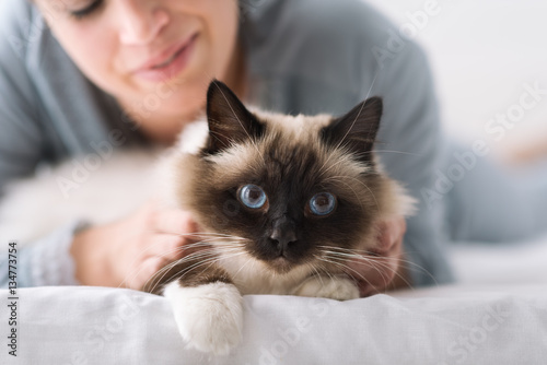 Cuddly cat on the bed Poster