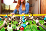 woman playing table football game