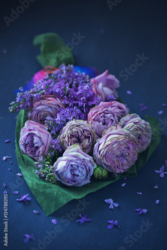 Beautiful bouquet for a birthday or Valentine's Day. Bouquet of purple roses on a dark background.