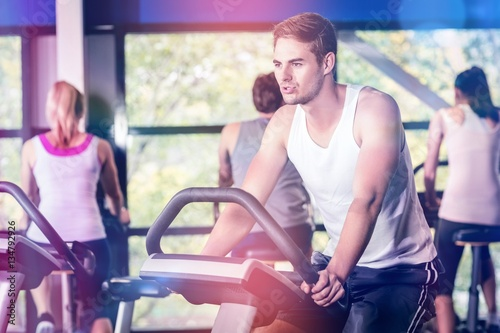Poster Fit man doing exercise bike