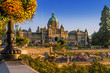 Parliament building, Victoria, BC; with inner harbor summer activities underway all around