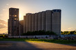 More grain silos at dusk
