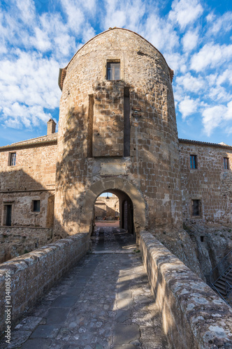 Fototapeta Sorano (Italy) - An ancient medieval hill town hanging from a tuff stone in province of Grosseto, Tuscany region
