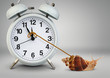 Snail pulling clock hand , time management concept