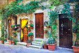 Charming floral streets of medieval towns of Italy. Pitigliano, Italy. artistic retro styled picture