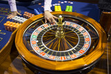 Wooden Roulette table in casino ball