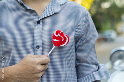 hand holding candy with right hand Poster