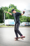 Teenage skateboarder standing