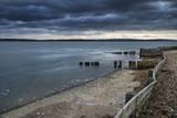 Moody sea landscape looking across Solent to Isle of Wight in En