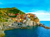 Colorful traditional houses on a rock over Mediterranean sea, Manarola, Cinque Terre, Italy