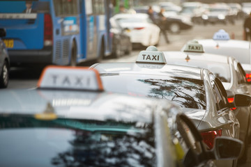 Taxi stand in a row on a city street