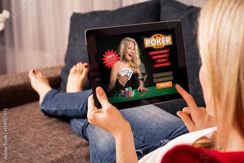 Woman playing poker on tablet плакат
