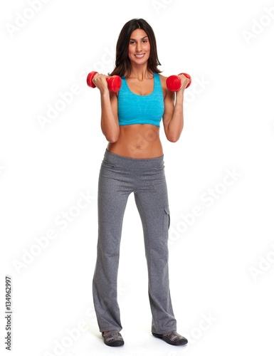 Valokuva Athletic girl with dumbbells.