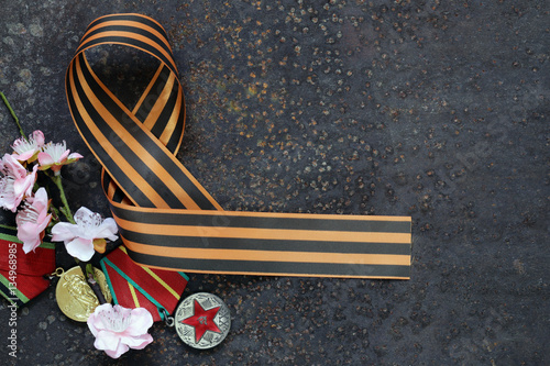 Poster Victory Day ribbon and spring flowers holiday symbols