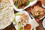 Four of Vietnamese dishes on wood table