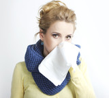 Young blond sick Rhinitis. Stuffy nose. Runny nose.blonde with a handkerchief.