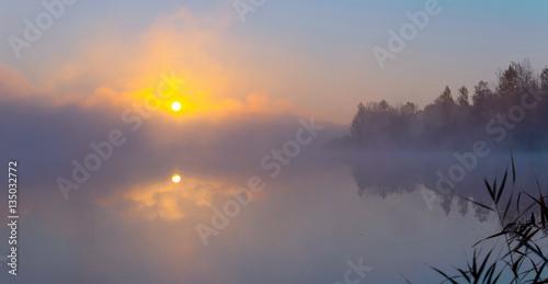 Panorama of beautiful foggy lake coast at sunrise moment. - 135032772