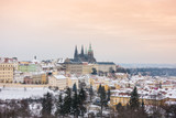 View of Prague and its Castle under the snow at sunset