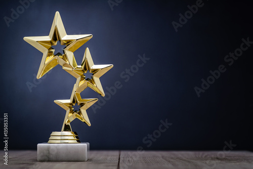 Gold winners award with three stars - 135053351