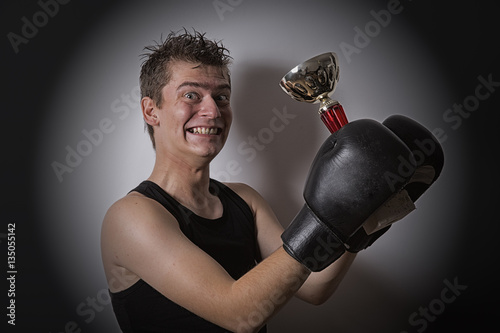 Poster Boxer holding a cup in his hands