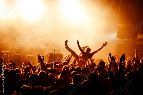 Crowd surfing during at concert