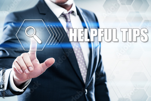 Business, technology, internet concept on hexagons and transparent honeycomb background. Businessman pressing button on touch screen interface and select helpful tips