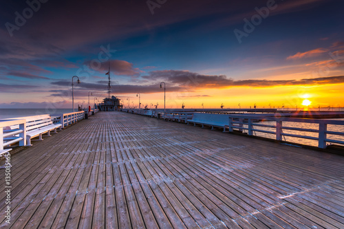 Plexiglas Lavendel Cold morning, Pier in Sopot at sunrise with amazing colorful sky. Winter in Poland.