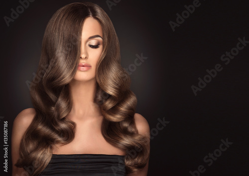 Poster Brunette  girl with long  and   shiny wavy hair