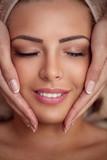 woman receiving professional face massage
