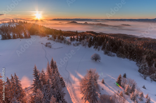 Poster Winter sunrise seen from the snow covered Luban peak, Gorce mountains, Poland