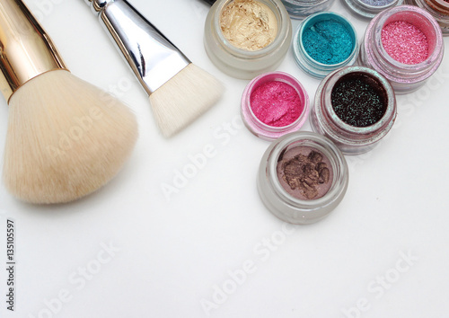 Brushes and makeup pigments. © romankyryliuk