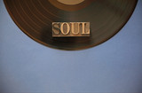 Black vinyl record with the word soul in metal type with room for copy