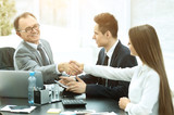 Business people shaking hands, making a deal, finishing up  meeting