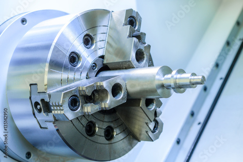 metal workpiece clamped in the lathe chuck CNC machine Poster
