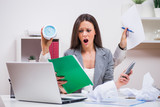 Young businesswoman is angry because she has too much work.