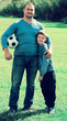Man and glad little boy spending time with ball