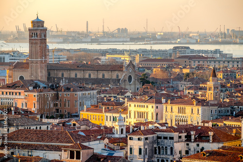 Staande foto Rome Panoramic aerial cityscape of Venice,with rooftops, the sea at sunset, Veneto, Italy.